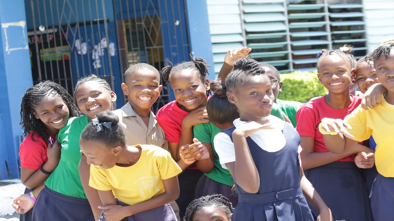 St Richard's Primary students were in a jovial mood after the release of GSAT results on Friday. (PHOTO: Marlon Reid)