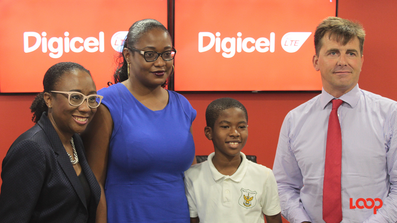 (Left to right) Digicel's Director of Marketing, Carolyn Shepherd; Digicel's Corporate Customer Care Executive, Karen Bridgeman with her son Joshua Carter; and CEO of Digicel Play, Charlie Clementson.