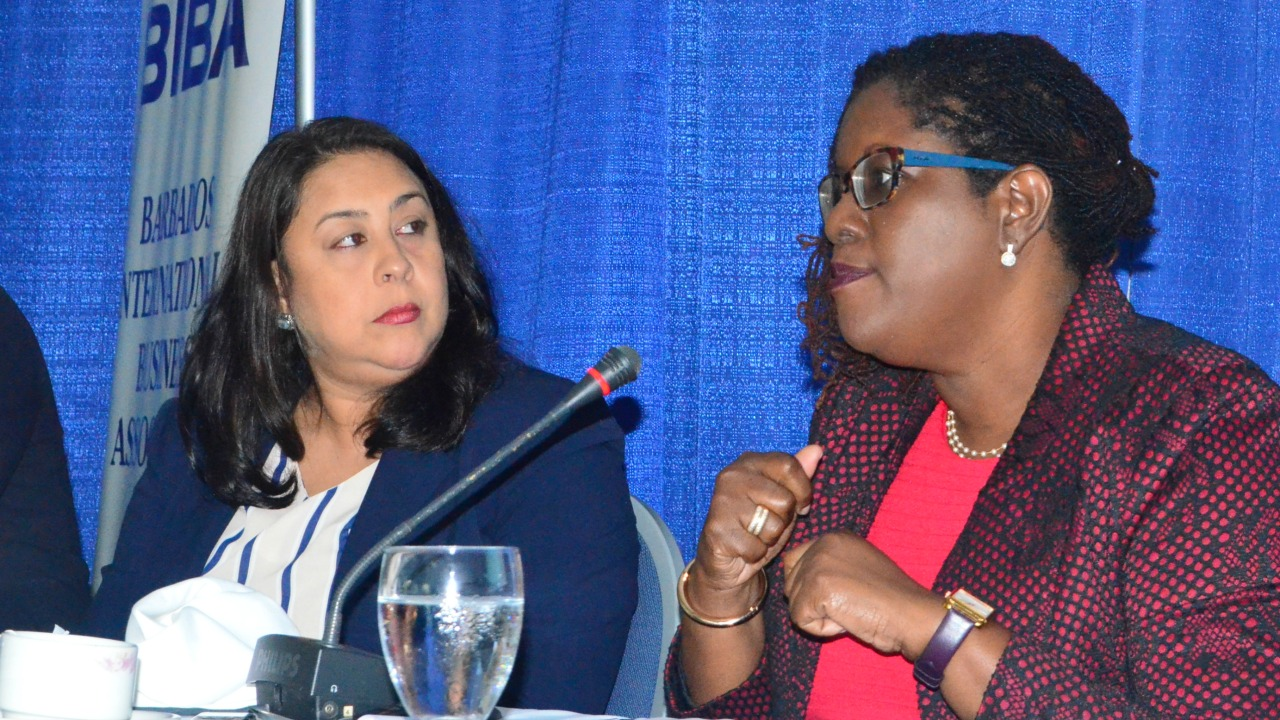 Acting Bank Secretary of the Central Bank of Barbados, Sadie Dixon (right) and Michelle Williams-Boyce, Compliance Manager for Republic Bank.