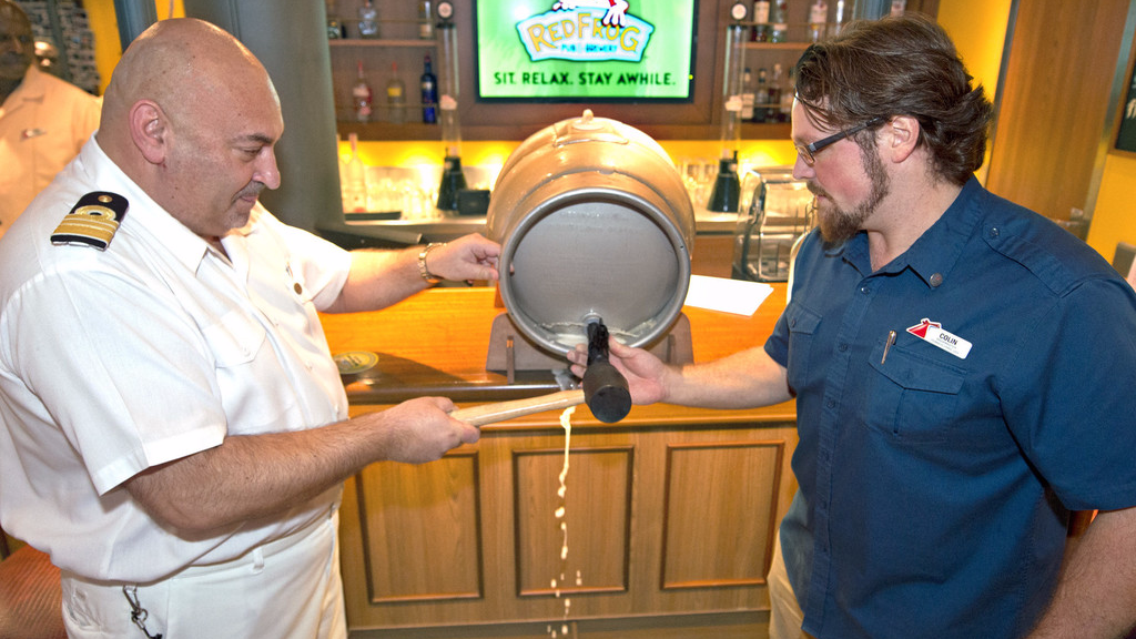 Carnival Vista brewmaster Colin Presby, right, and hotel director Pierre Camilleri tap a traditional 10-gallon firkin cast of the new Miami Guava Wheat beer Saturday, May 20, 2017, on the Carnival Vista in Miami.