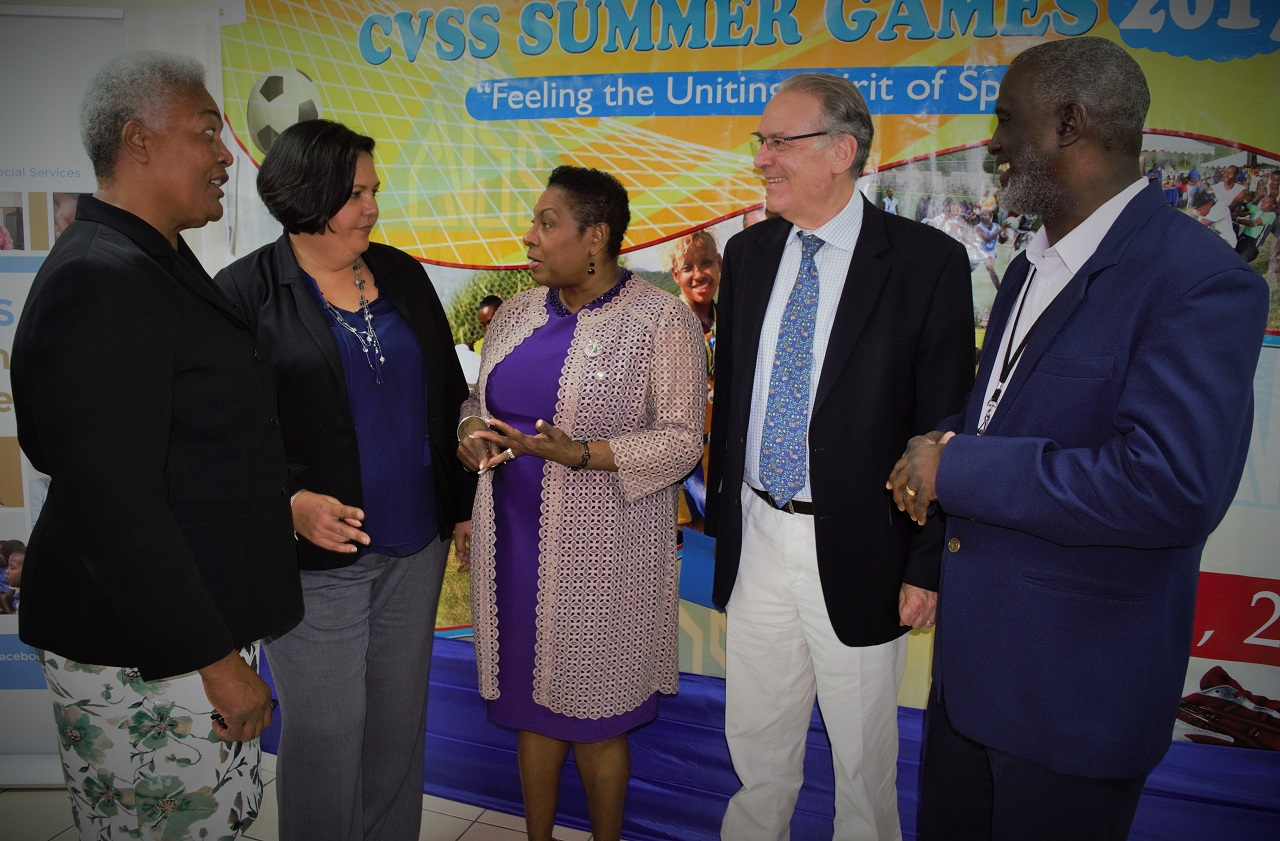 Sports Minister Olivia Grange (3rd left) in conversation with CEO of CVSS, Winsome Wilkins and Saffrey Brown at the launch of the CVSS 2017 Summer Games at the National Volunteer Centre in Kingston. Also taking part in the discussion are His Excellency Josep Bosh Bessa, Ambassador of Spain (2nd right) and General Manager of SDF, Denzil Wilks (right)
