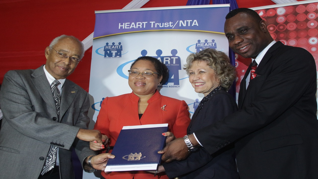 Noel DaCosta, Chairman, D&G Foundation; Dr. Marcia Rowe Amonde, Senior Director TVET Development and Support Systems; Elizabeth Terry, Acting Senior Director, Workforce Development and Employment, the HEART Trust/NTA; and Dean-Roy Bernard, Permanent Secretary, Ministry of Education, Youth and Information at the signing of a Memorandum of Understanding to establish the 2017/2018 installment of the Red Stripe Learning For Life initiative.