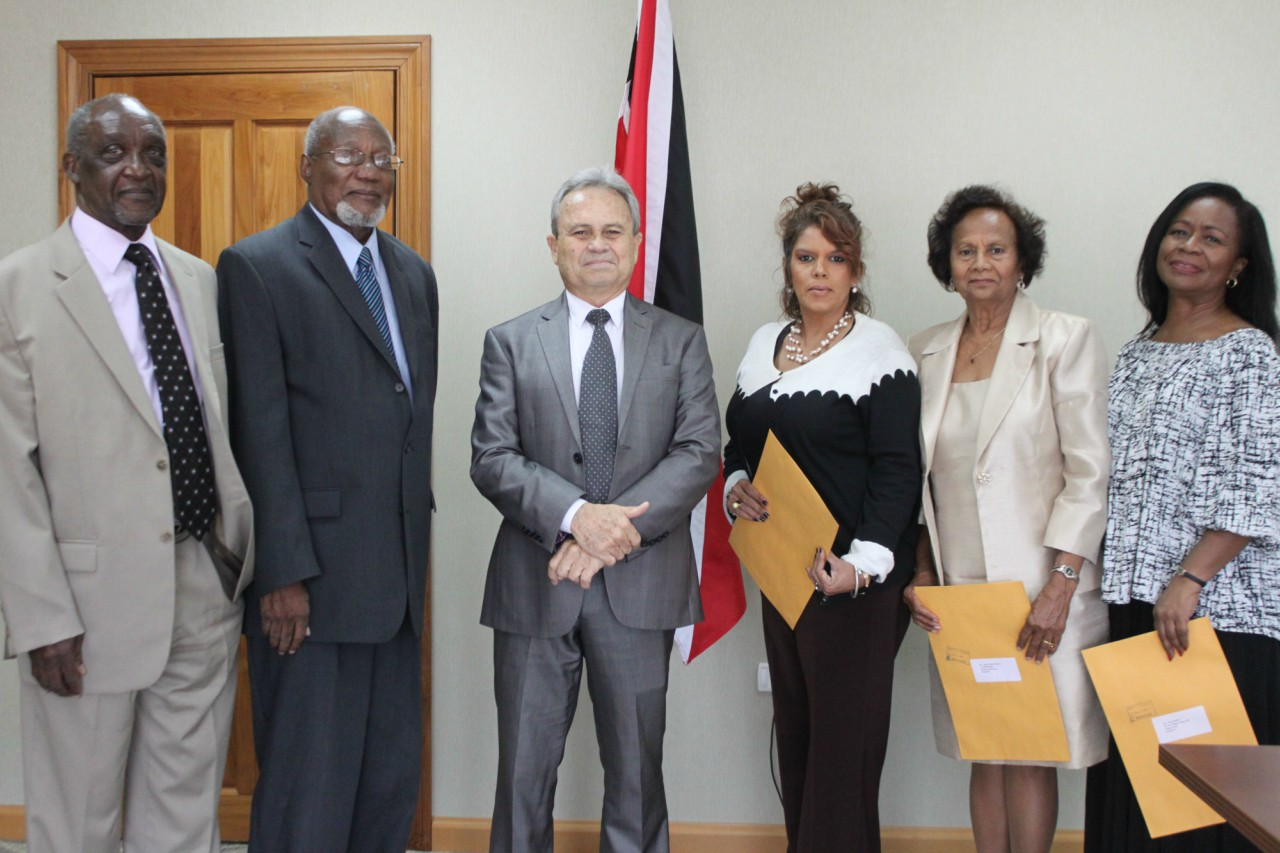 Finance Minister Colm Imbert is flanked by new members of the Statutory Authorities Services Commission. From left to right are Mr. Kenneth Parker, Dr. Christopher Thomas, Mrs. Catherine Dookie, Mrs. Dulcie Ojah-Maharaj and Mrs. Irma Burkett.