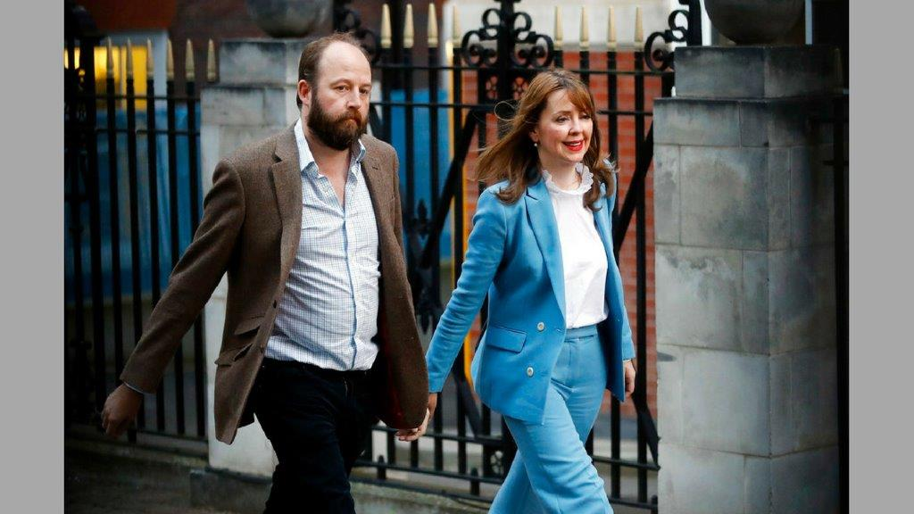 In this Friday, June 9, 2017 file photo, Prime Minister Theresa May's chief of staff Nick Timothy, left, and Joint-chief of staff Fiona Hill leave Conservative Party headquarters in London. (AP Photo/Frank Augstein, file)
