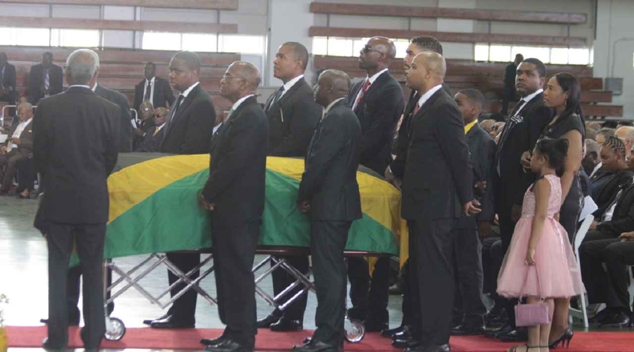 The casket bearing the remains of president of the Jamaica Football Federation (JFF), Captain Horace Burrell  is being surrounded by family members and pallbearers. At the back of the casket (from left) are Zuri Piggott, granddaughter of Captain Burrelll; daughter Dr Tiphani Burrell-Piggott and sons Romario Burrell and  Major Jaeden Burrell.