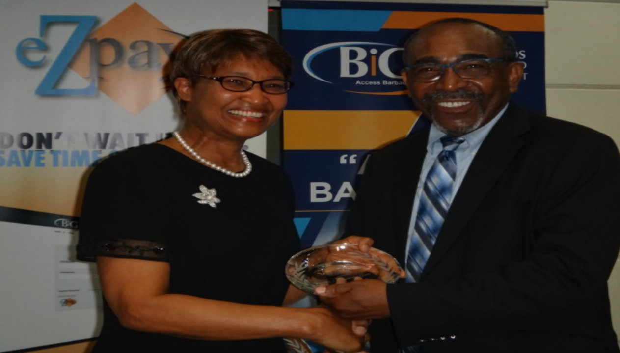 Senator Darcy Boyce (right), presented an award to Bernadette Lewis (left), the Secretary General of the Caribbean Telecommunication Union