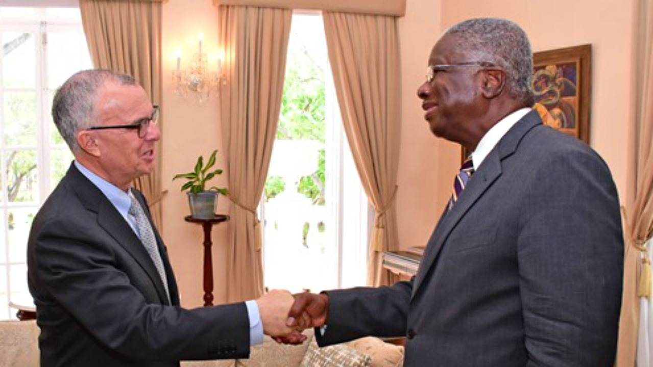 Prime Minister Freundel Stuart greets new Chancellor of the University of the West Indies (UWI), Robert Bermudez, at their recent courtesy call at Ilaro Court. (PHOTO: C.Pitt/BGIS)