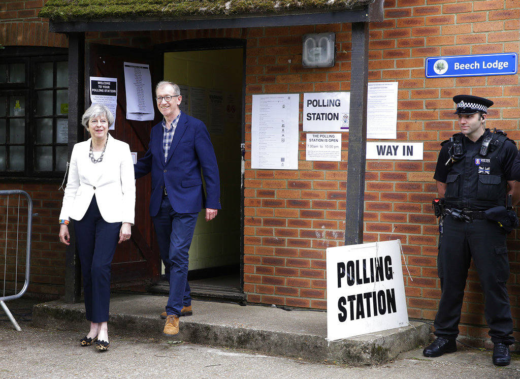 Britain's Prime Minister Theresa May leaves with her husband Philip after voting in the general election at polling station in Maidenhead, England, Thursday, June 8, 2017. (AP Photo/Alastair Grant)