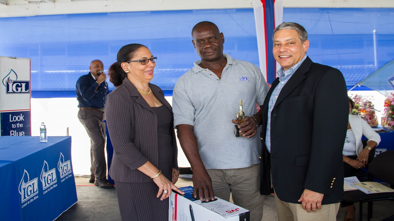 From left to right: Shahine Robinson, Minister of Labour and Social Security, Vernon Clarke, who secured top honours at the IGL Health, Safety & Environment (HS&E) Road Safety Award Ceremony, and Wayne Kirkpatrick, General Manager, IGL Ltd.