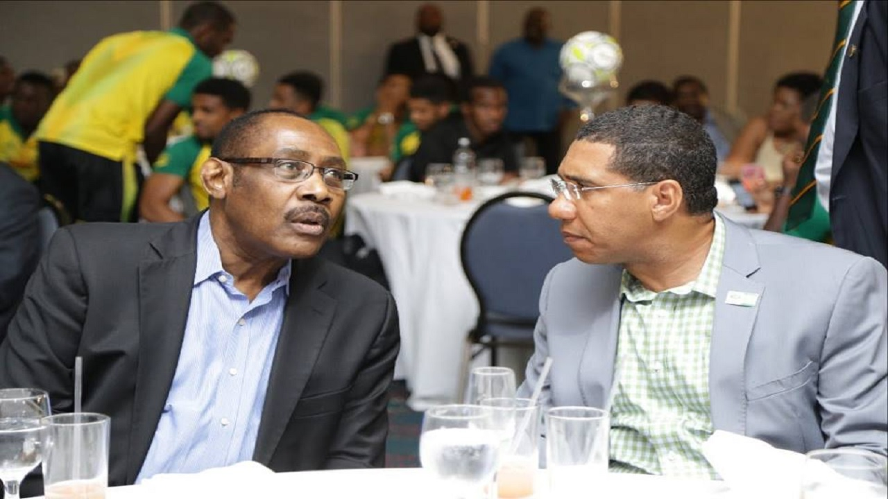 Prime Minister Andrew Holness (right) with Captain Horace Burrell.