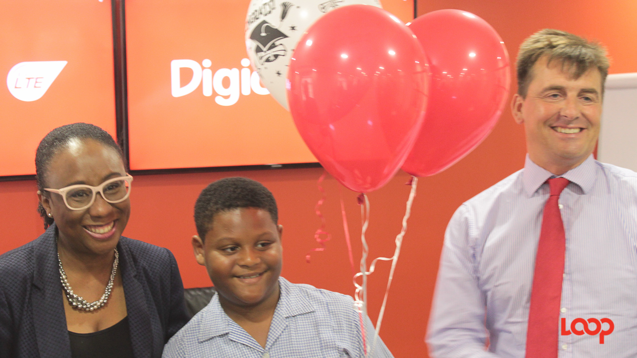 (Left to right) Digicel's Director of Marketing, Carolyn Shepherd; Javon Linton of the Blackman and Gollop Primary School; and CEO of Digicel Play, Charlie Clementson.