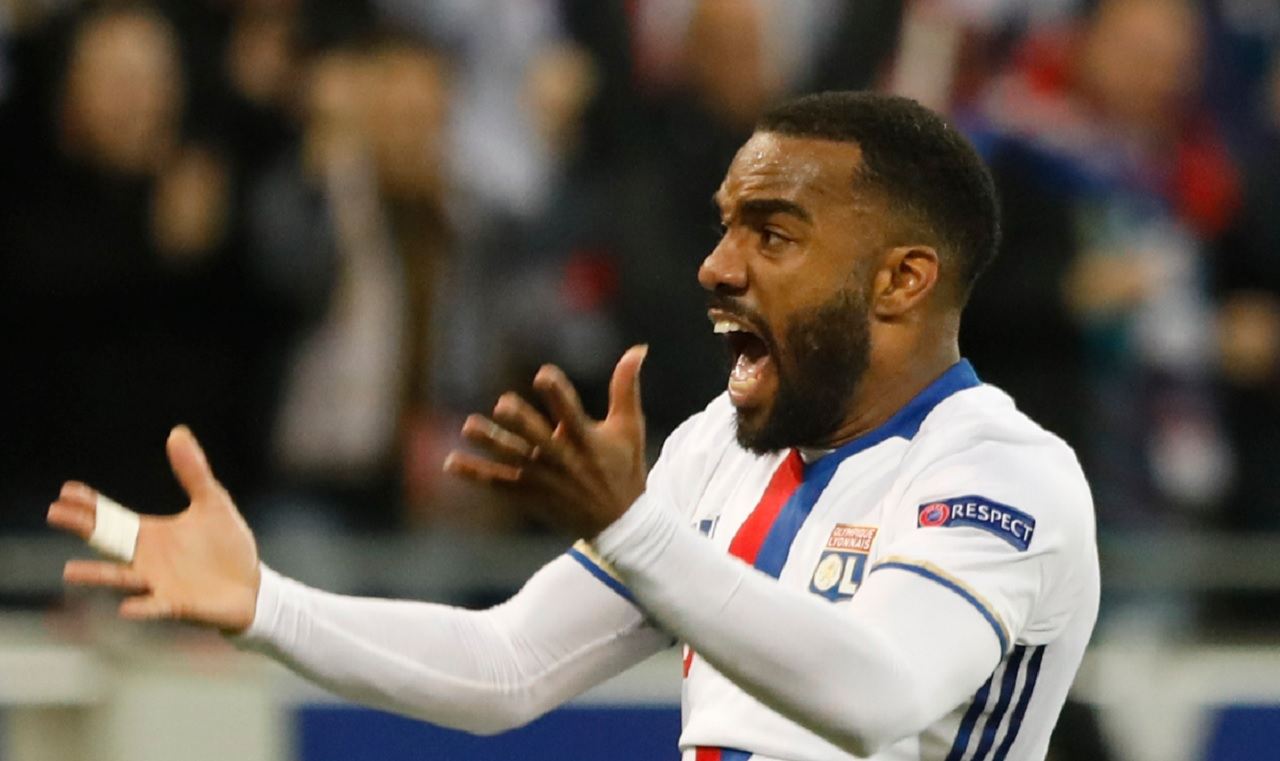 A Thursday, May 11, 2017 file photo of Lyon's Alexandre Lacazette reacting after his team scored their side's third goal during the second leg semi final soccer match between Olympique Lyon and Ajax in the Stade de Lyon, Decines, France.