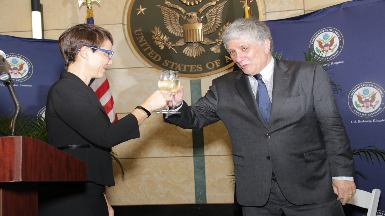 Foreign Affairs and Foreign Trade Minister, Kamina Johnson-Smith raised a toast to the USA's Independence with US Ambassador Luis Moreno. (PHOTOS: Llewellyn Wynter)