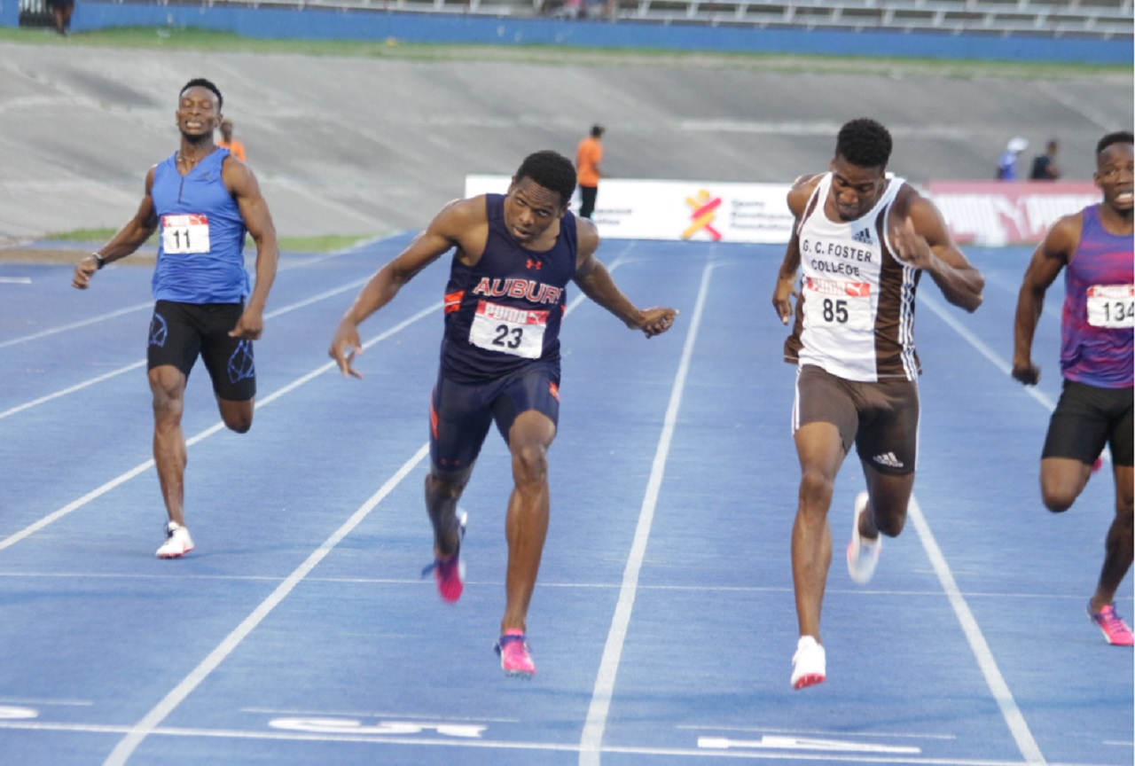 Nathon Allen holds off Demish Gaye to win the men's 400m title at the National Senior Championships at the National Stadium on Sunday.