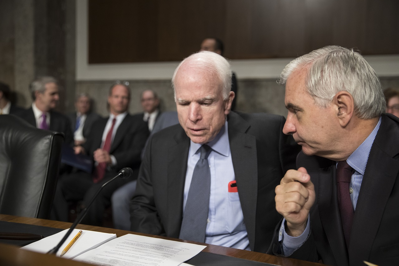 Senate Armed Services Committee Chairman John McCain, R-Ariz., left, confers with Sen. Jack Reed, D-R.I., the ranking member, at the start of a hearing at the Capitol in Washington, Tuesday, June 20, 2017.