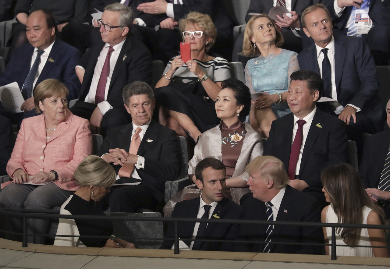 Leaders, including German Chancellor Angela Merkel, left, and their partners attend a concert at the Elbphilharmonie concert hall on the first day of the G-20 summit in Hamburg, northern Germany, Friday, July 7, 2017.