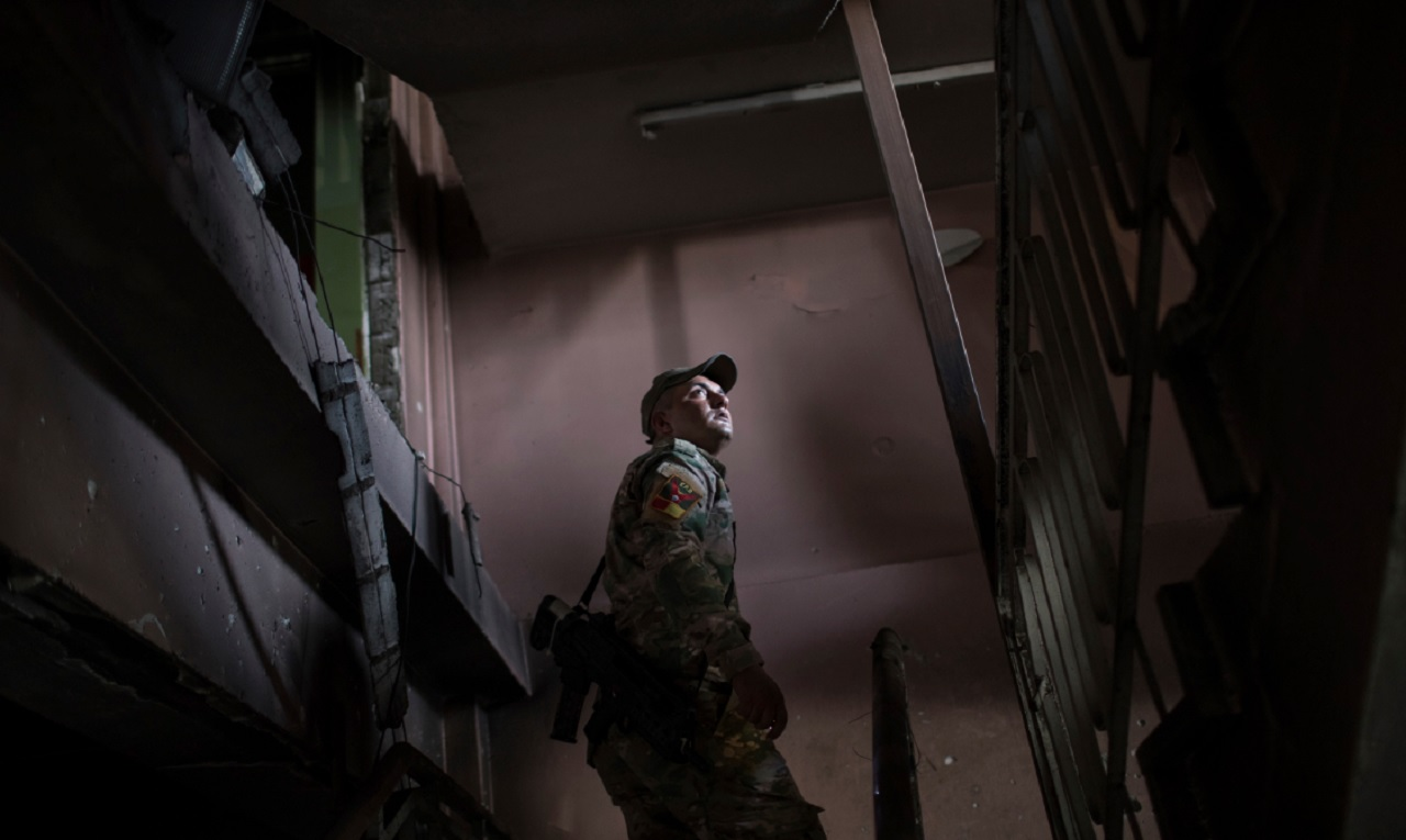 A Federal Police Rapid Response Force fighter walks inside a building at Mosul's main hospital complex after it was retaken by Iraqi forces during fighting against Islamic State militants, in Mosul, Iraq, Tuesday, July 4, 2017.