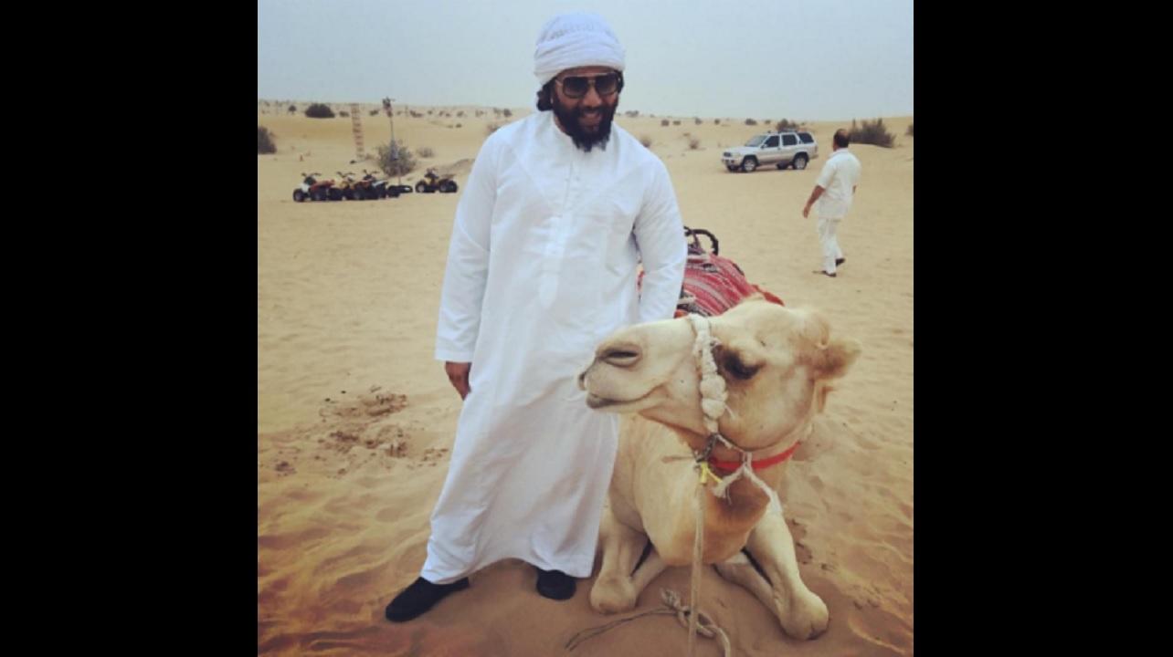 Ky-Mani Marley in a desert in Dubai.