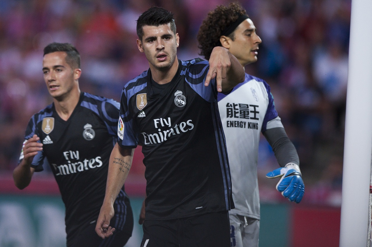 A Saturday May 6, 2017 file photo of Real Madrid's Alvaro Morata, center, celebrating scoring his goal against Granada during a Spanish La Liga soccer match between Granada and Real Madrid in Granada, Spain. Chelsea is set to strengthen its attacking options for its Premier League title defense by signing Alvaro Morata from Real Madrid.
