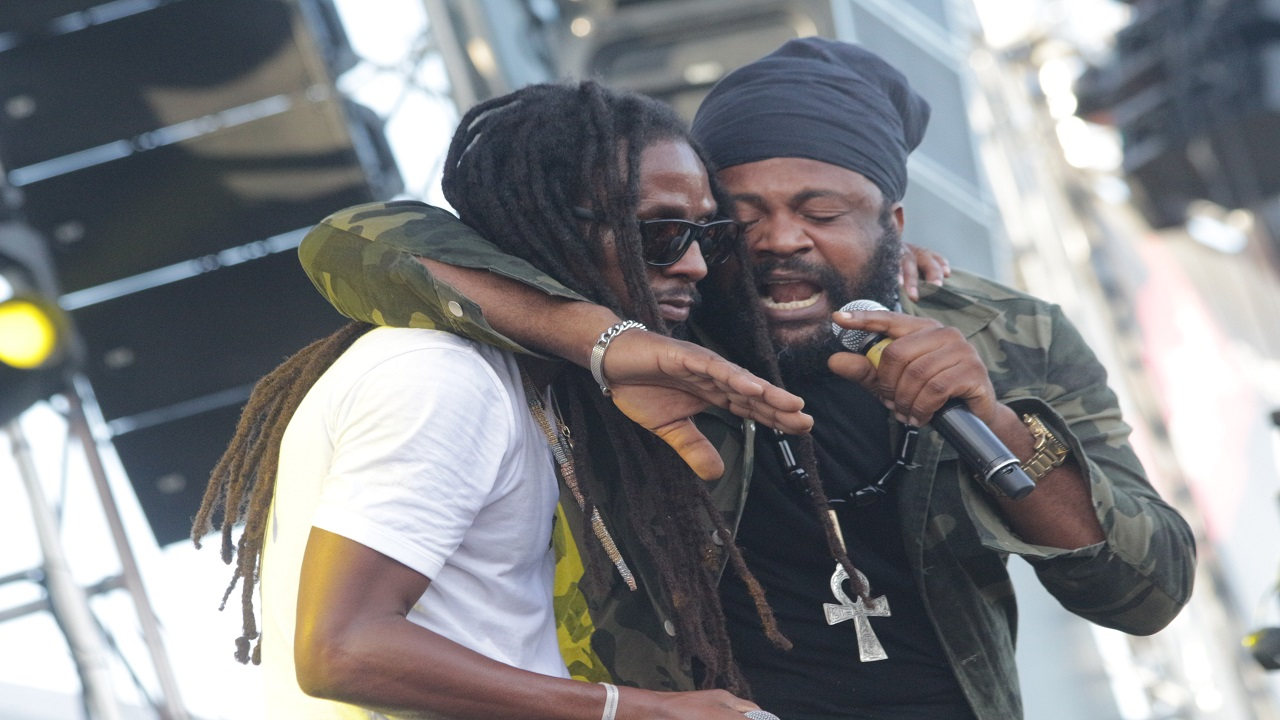 Jah Cure (left) with Fantan Mojah on stage at Reggae Sumfest on Sunday morning. (Photo: Marlon Reid)