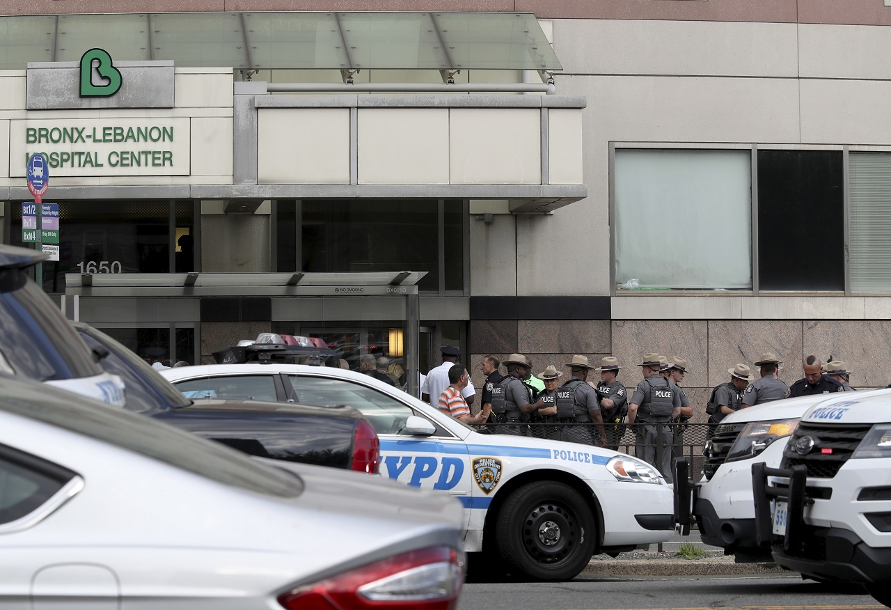 Police gather outside Bronx Lebanon Hospital in New York after a gunman opened fire and then took his own life there on Friday, June 30, 2017. The gunman, identified as Dr. Henry Bello who used to work at the hospital, returned with a rifle hidden under his white lab coat, law enforcement officials said.