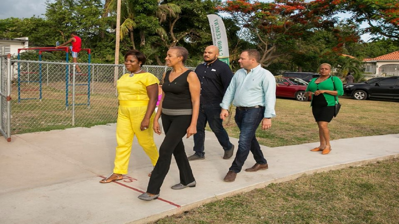 (From left) Cheryl Wright, president of the Hope Pastures Citizens Association; Eastern St Andrew MP, Fayval Williams; Councillor for the Mona Division Andrew Bellamy; and Carib Cement GM Peter Donkersloot take a walk inside the park. (Photo:Hope Pastures Citizens Association Facebook)