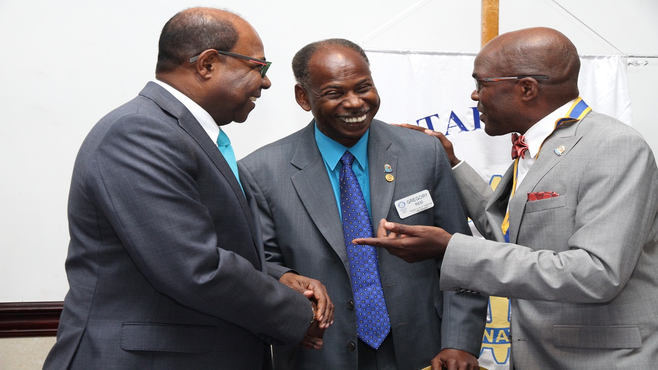 (From left) Tourism Minister Edmund Bartlett, Immediate Past President of the Rotary Club of Kingston Gregory Reid and the President of the Rotary Club of Kingston Michael Buckle seem to be in good spirits ahead of the Tourism Minister's address to Rotarians at their weekly luncheon.