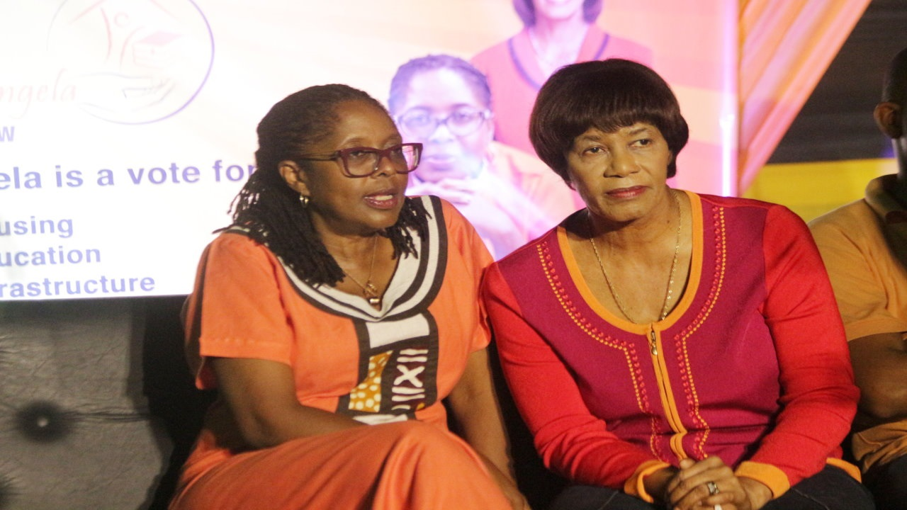 Retired former Prime Minister and Member of Parliament for South West St Andrew, Portia Simpson Miller (right) with Angela Brown Burke at a rally on Friday night.