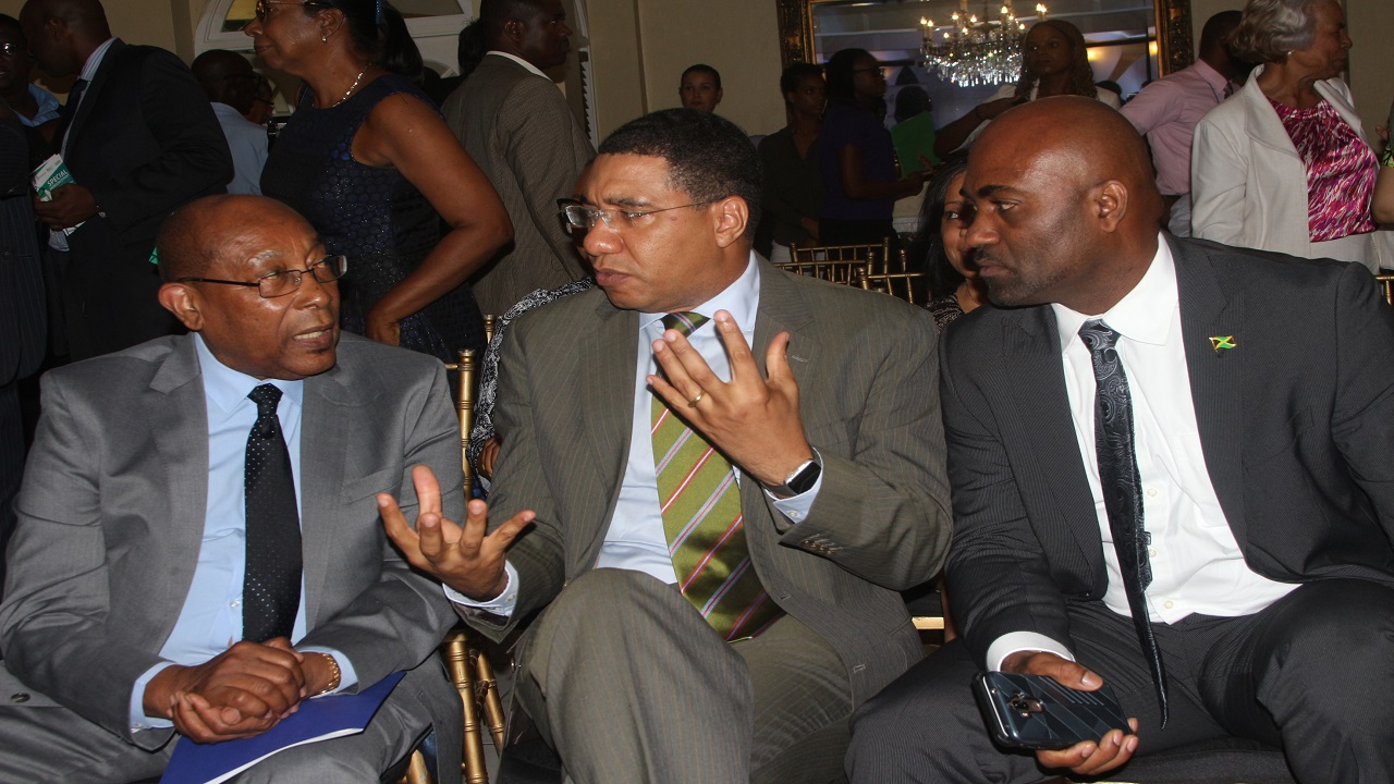 Prime Minister Andrew Holness (centre) makes a point in discussion with scientific researcher Dr Henry Lowe (left) and Science Minister Dr Andrew Wheatley. (PHOTO: Marlon Reid)
