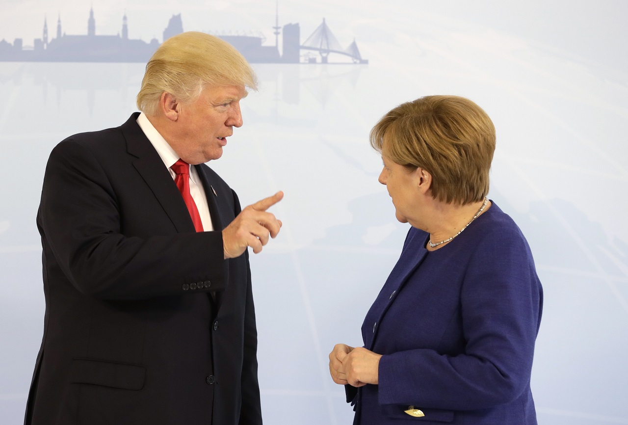 U.S. President Donald Trump, left, and German Chancellor Angela Merkel pose for a photograph prior to a bilateral meeting on the eve of the G-20 summit in Hamburg, northern Germany, Thursday, July 6, 2017. The leaders of the group of 20 meet July 7 and 8.