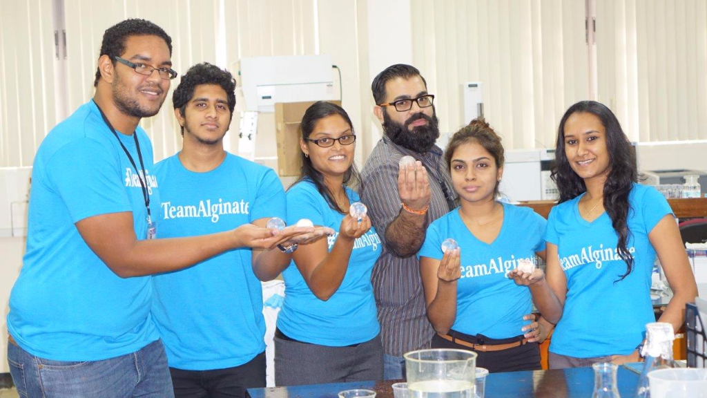 (Photo L-R: Dr Keeran Ward with his team at the Department of Chemical Engineering. Edible Ooho water bottle design by SkippingRocksLab (UK).