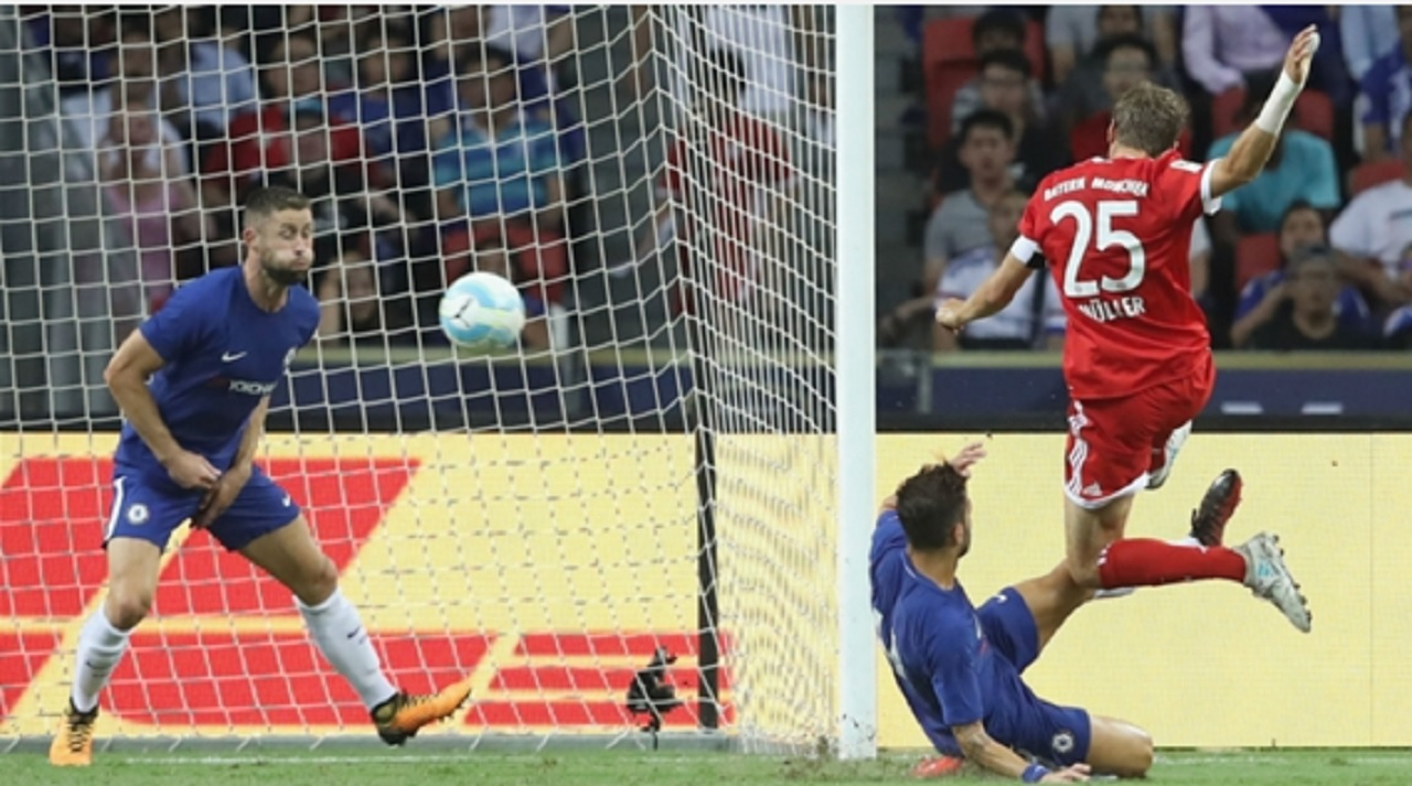 Thomas Muller scores for Bayern Munich against Chelsea.