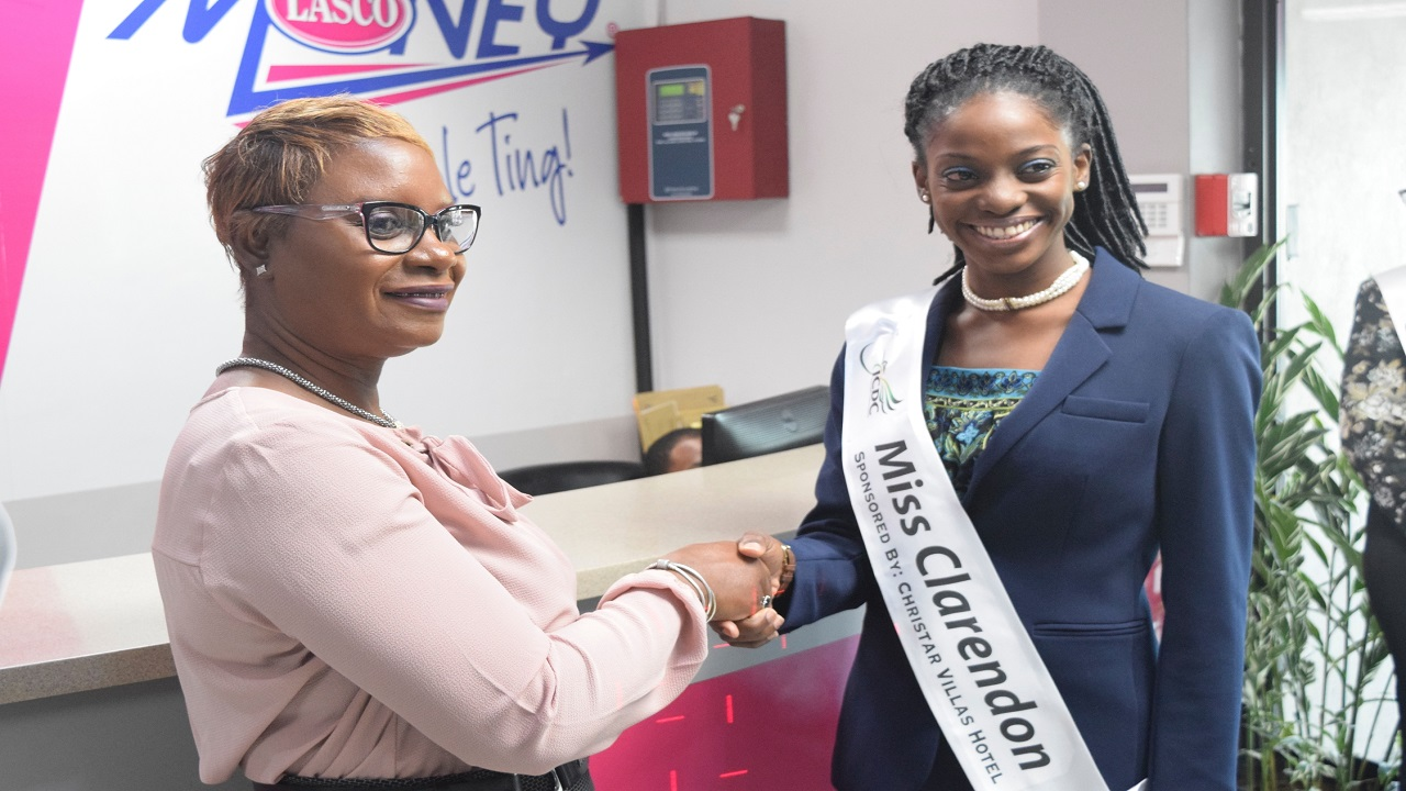 Jacinth Hall Tracey (left), Managing Director of LASCO Financial Services Limited (LFSL), greets JCDC Festival Queen finalist Vivianna Miller, Miss Clarendon, during a courtesy call to LASCO Money on Thursday.