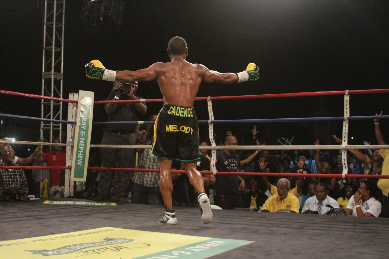 Jamaican Sakima Mullings acknowledges the crowd after defeating Canadian Phil Rose to win a second Contender Boxing Series title on Wednesday night at Mico University.