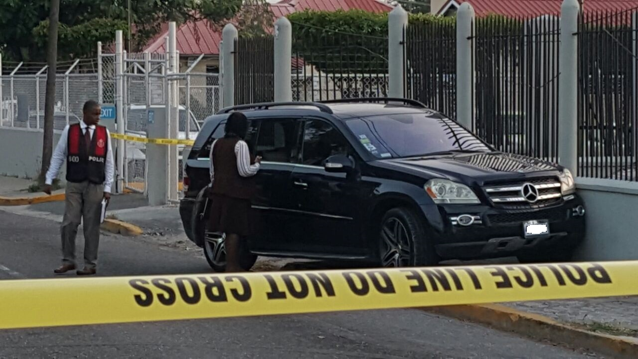The Mercedes Benz that was shot up along Ruthven Road in St Andrew on Tuesday.