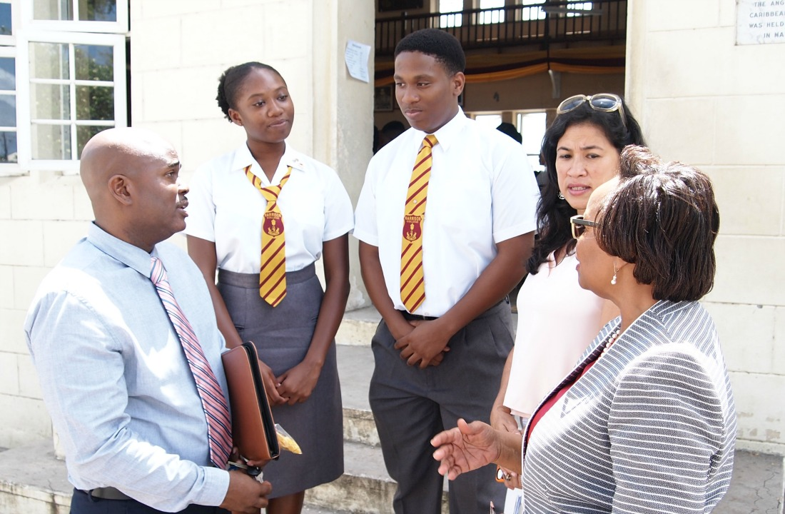 Sixth form Year Head, Carl Applewaithe (far left) and Principal Juanita Wade (far right) interacting with students and parents during Harrison College Open Day.