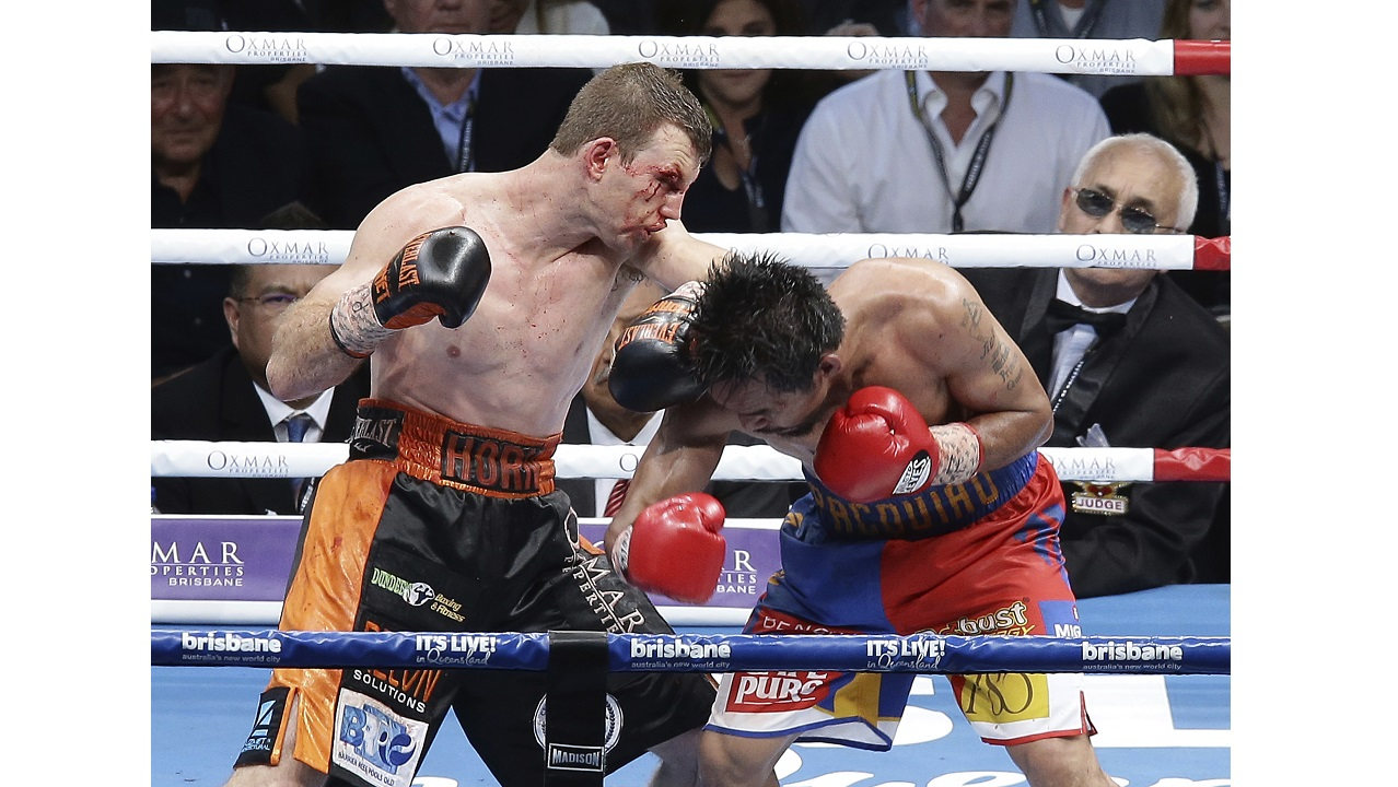 Jeff Horn of Australia, left, and Manny Pacquiao of the Philippines fight during their WBO World welterweight title fight in Brisbane, Australia, Sunday, July 2, 2017. (PHOTOS: AP)