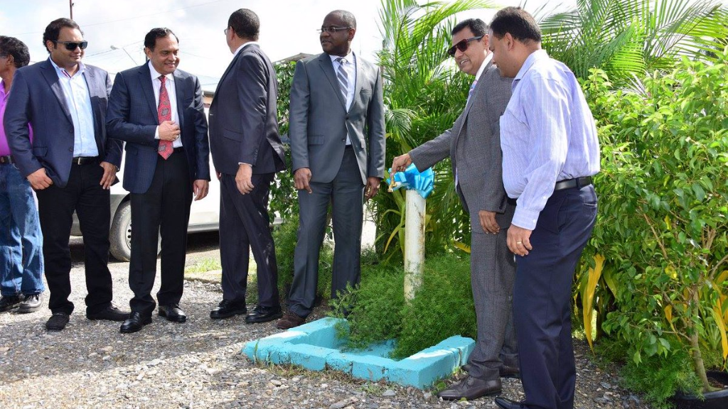 (Photo: Minister of Works and Transport Rohan Sinanan and others view the completed work at Leemond Road, Fishing Pond)