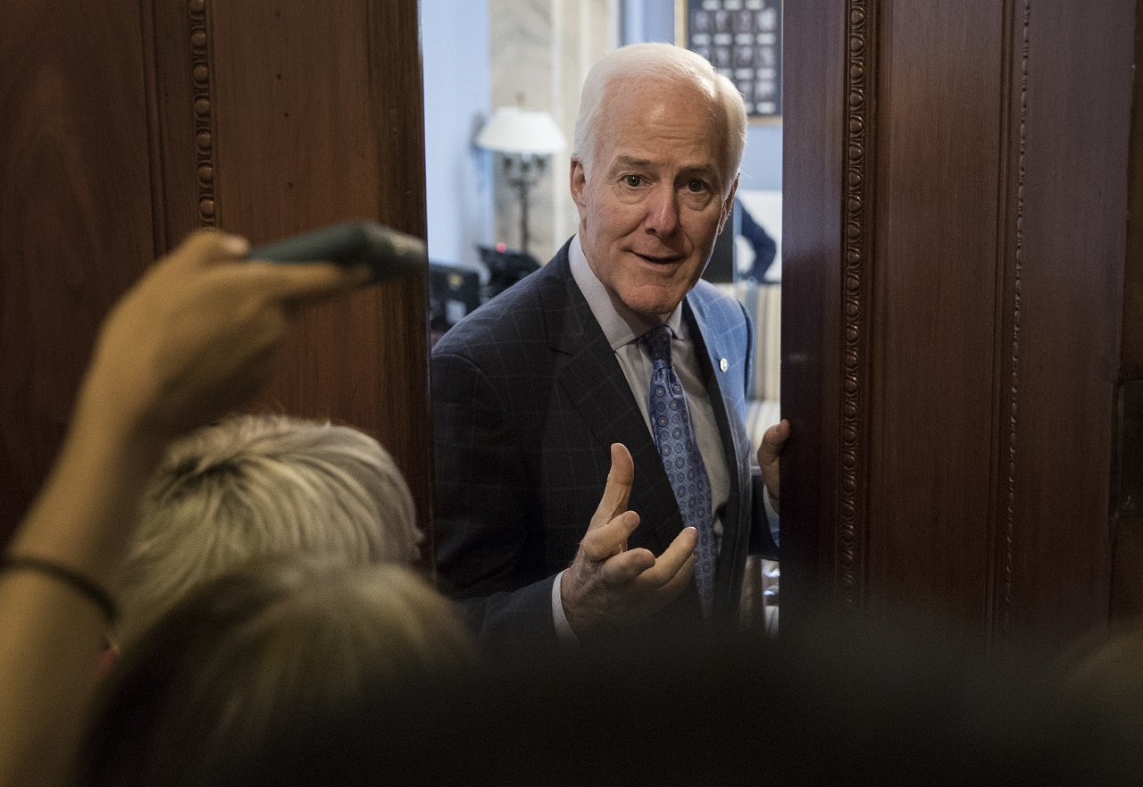 Senate Majority Whip John Cornyn of Texas talks to reporters outside his office on Capitol Hill in Washington, Wednesday, July 26.