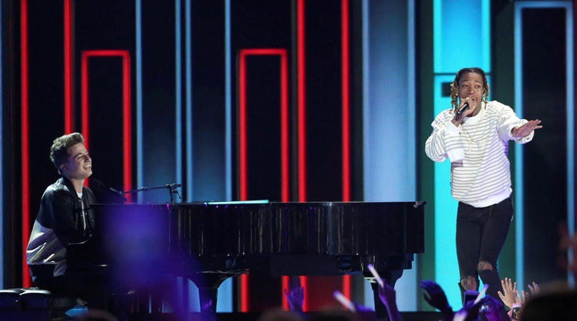 FILE - Charlie Puth, left, and Wiz Khalifa perform at the Kids' Choice Awards at The Forum in Inglewood, Calif. in 2016.
