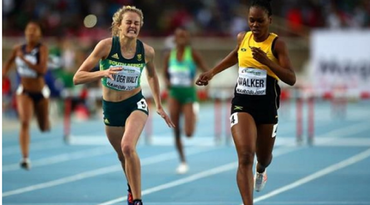 South Africa's Zeney van der Walt (left) gets the better of Jamaican Shanique Walker in the girls' 400-metre final on Saturday. (PHOTO: IAAF).