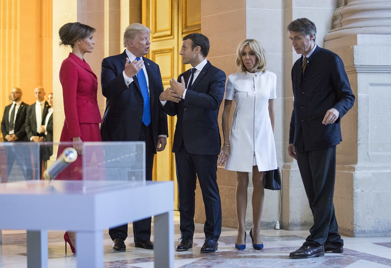 President Donald Trump, first lady Melania Trump, French President Emmanuel Macron and his wife Brigitte Macron, tour Marechal Foch's Tomb with David Guillet, director of the Army Museum, at Les Invalides in Paris, Thursday, July 13, 2017.