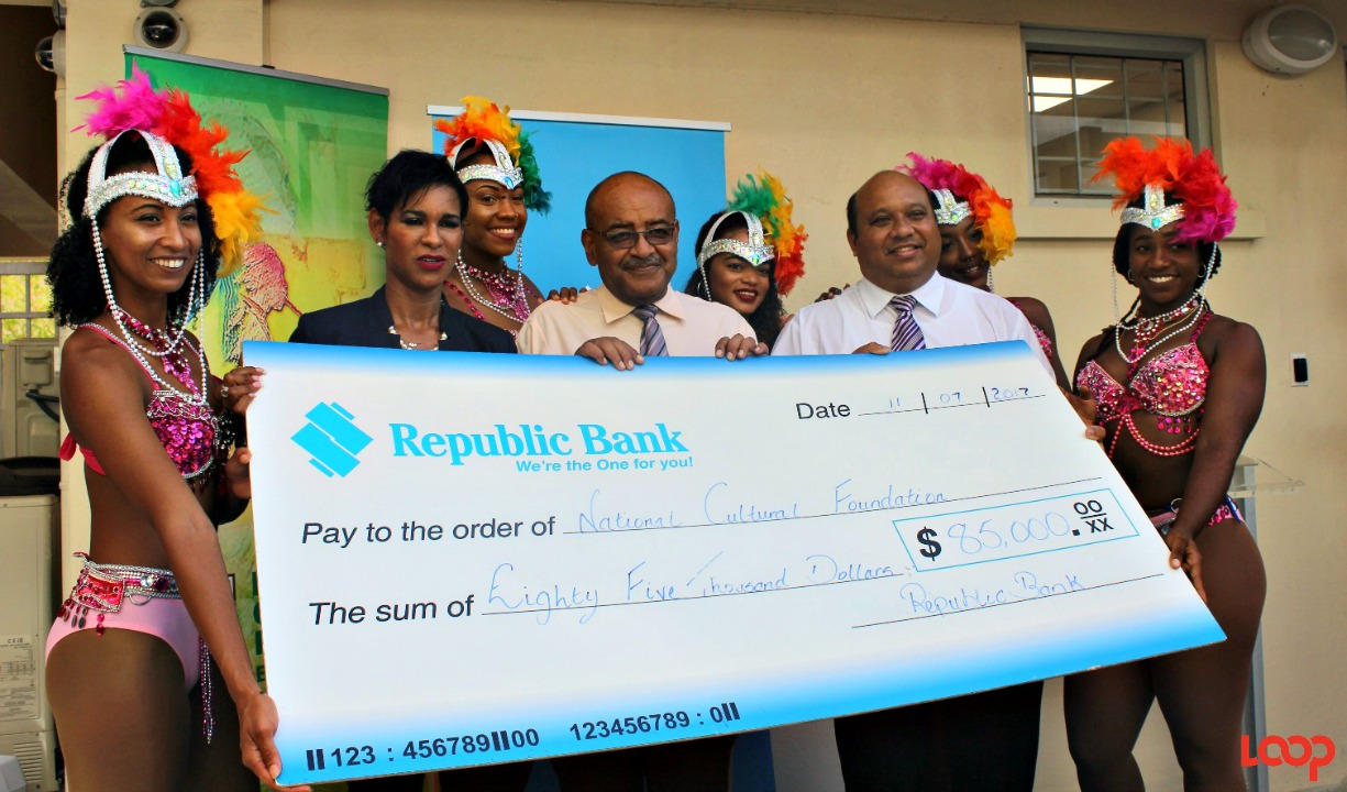 General Manager of Retail Banking at Republic Bank, Sharon Zephirin, NCF Chief Executive Officer and Republic Bank's General Manager of Corporate and Commercial, Sean Husain, with members of the Riddim Tribe dance troupe at the cheque presentation for the 2017 Republic Bank Grand Kadooment.