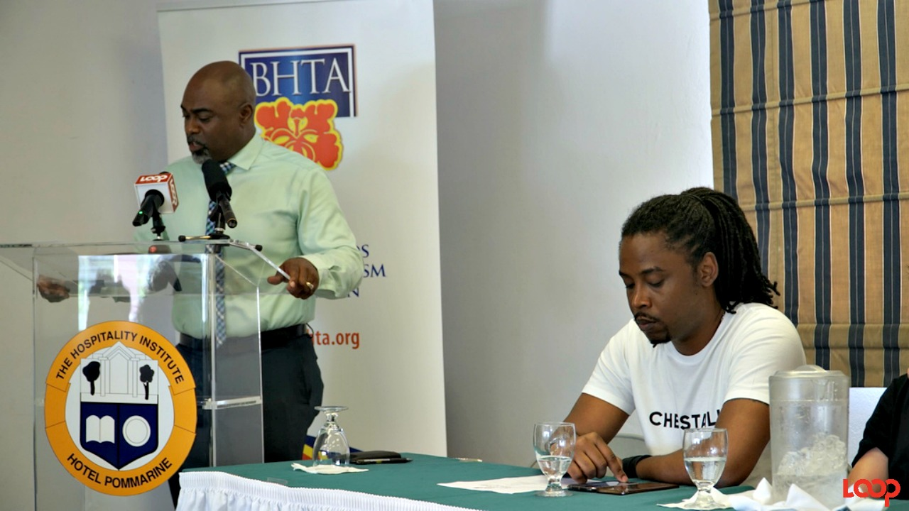 (left) CEO of the BHTA Rudy Grant addressing the gathering.