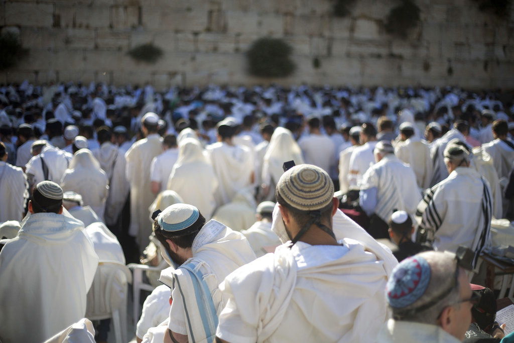 In this May 24, 2017 file photo, Jewish men pray at the Western Wall, the holiest place where Jews can pray, in Jerusalem's Old City. Israel's rabbinical authorities have compiled a list of overseas rabbis whose authority they refuse to recognize when it comes to certifying the Jewishness of someone who wants to get married in Israel. (AP Photo/Ariel Schalit, File)