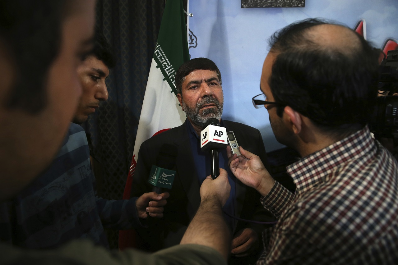 """The spokesman of Iran's Revolutionary Guard, Gen. Ramazan Sharif speaks with media members at the conclusion of his press conference in Tehran, Iran, Tuesday, June 20, 2017. Sharif, said all six ballistic missiles it launched on Syria hit their targets, according to """"local sources and drone films."""" Iran fired ballistic missiles at IS targets in eastern Syria, in the province of Deir el-Zour, later on Sunday."""