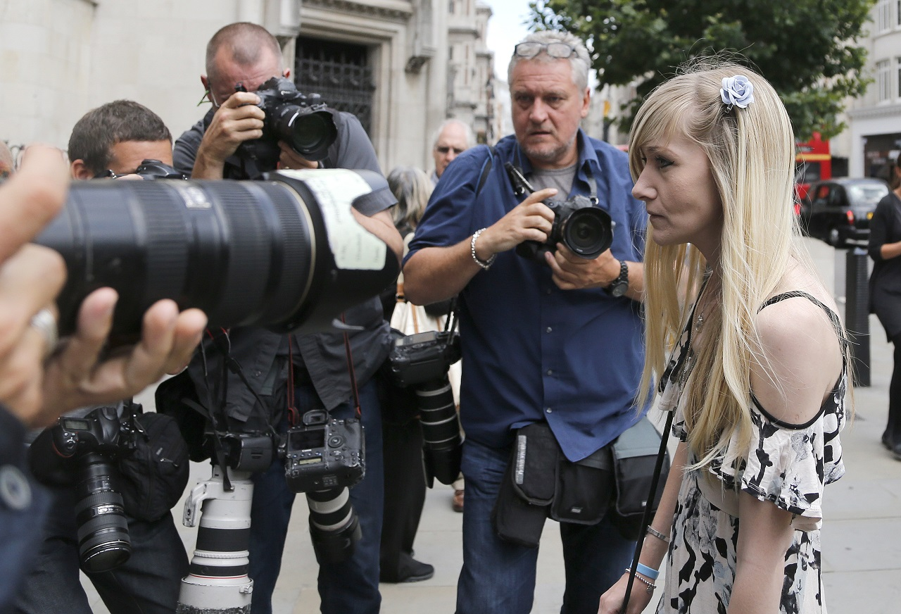 Connie Yates, mother of critically ill baby Charlie Gard arrives at the Royal Court of Justice in London, Tuesday, July 25, 2017. Lawyers for the family of critically ill infant Charlie Gard and the hospital treating him were returning to court for a hearing Tuesday, a day after the baby's parents said they were dropping their long legal battle to get him experimental treatment.