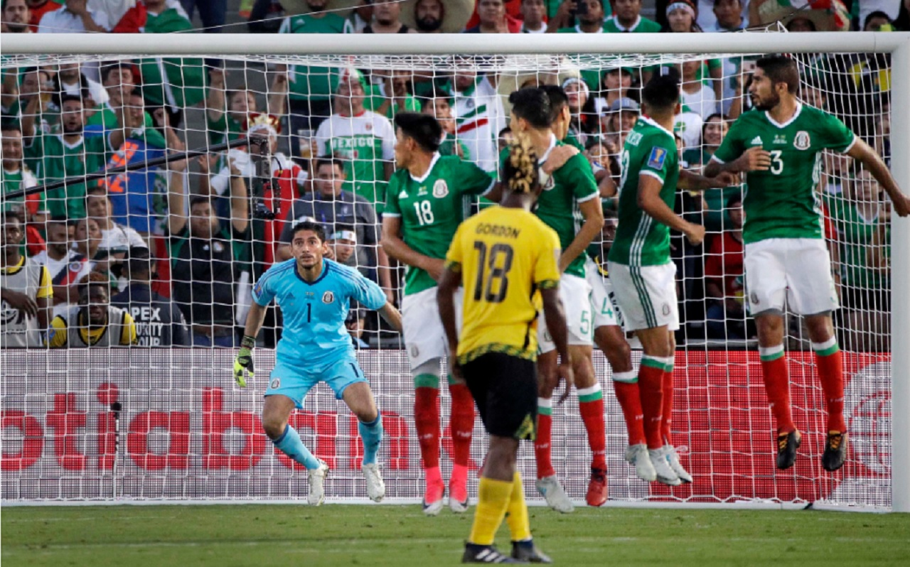 Mexico Goalkeeper Jesus Corona, left, watches a goal scored by Jamaica's Kemar Lawrence during the second half of their CONCACAF Gold Cup semifinal match in Pasadena, Calif., Sunday, July 23, 2017.