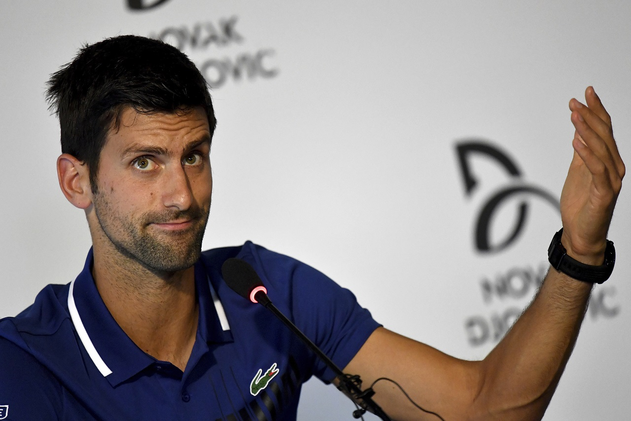 Novak Djokovic gestures, during a press conference in Belgrade, Serbia, Wednesday, July 26, 2017. Djokovic will sit out the rest of this season because of an injured right elbow.