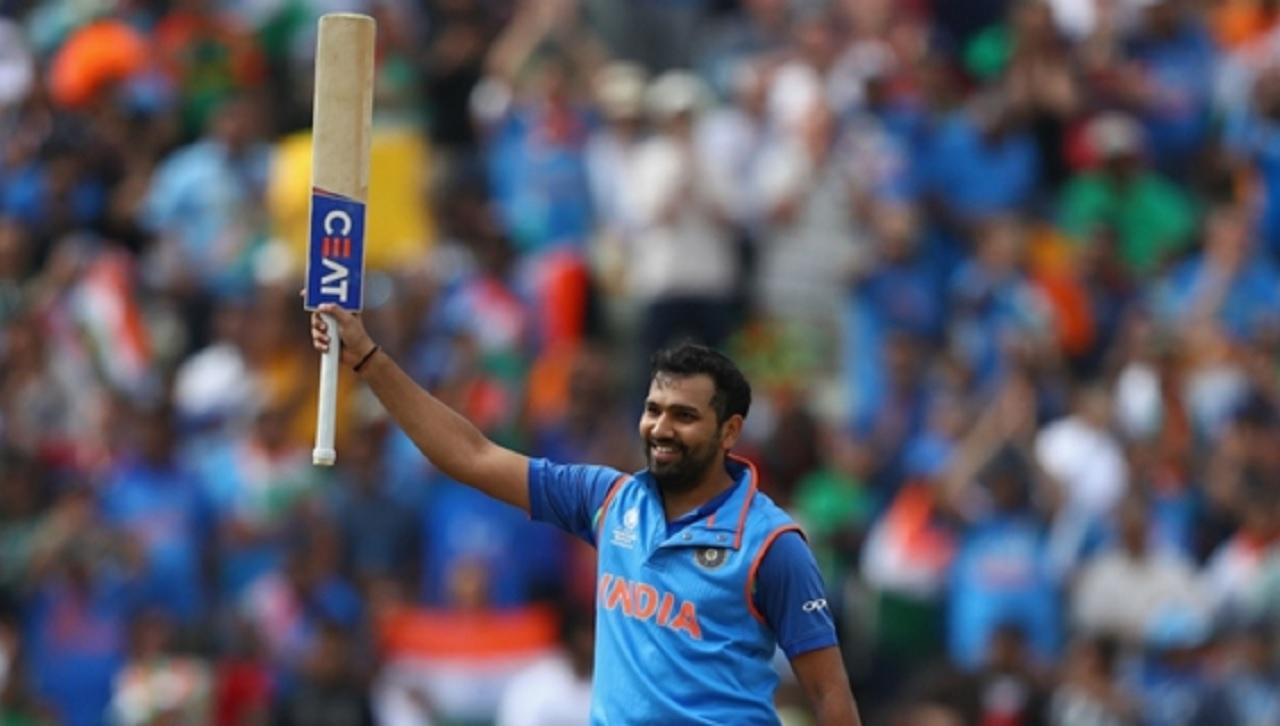 India's Rohit Sharma celebrates his century against Bangladesh.